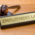 Gavel and sign that reads Employment Law