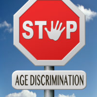 A stop sign that reads age discrimination