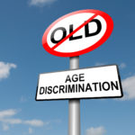 Age discrimination road sign and no old people allowed sign with blue sky background