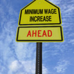 minimum wage increase ahead road sign