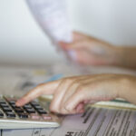 Woman calculates value of receipts for taxation purposes