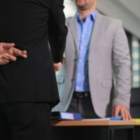 Business man shaking hand with lie sign