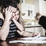 men with financial stress at home