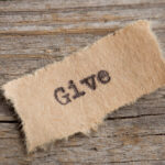 give word on a piece of paper close up, business creative motivation concept